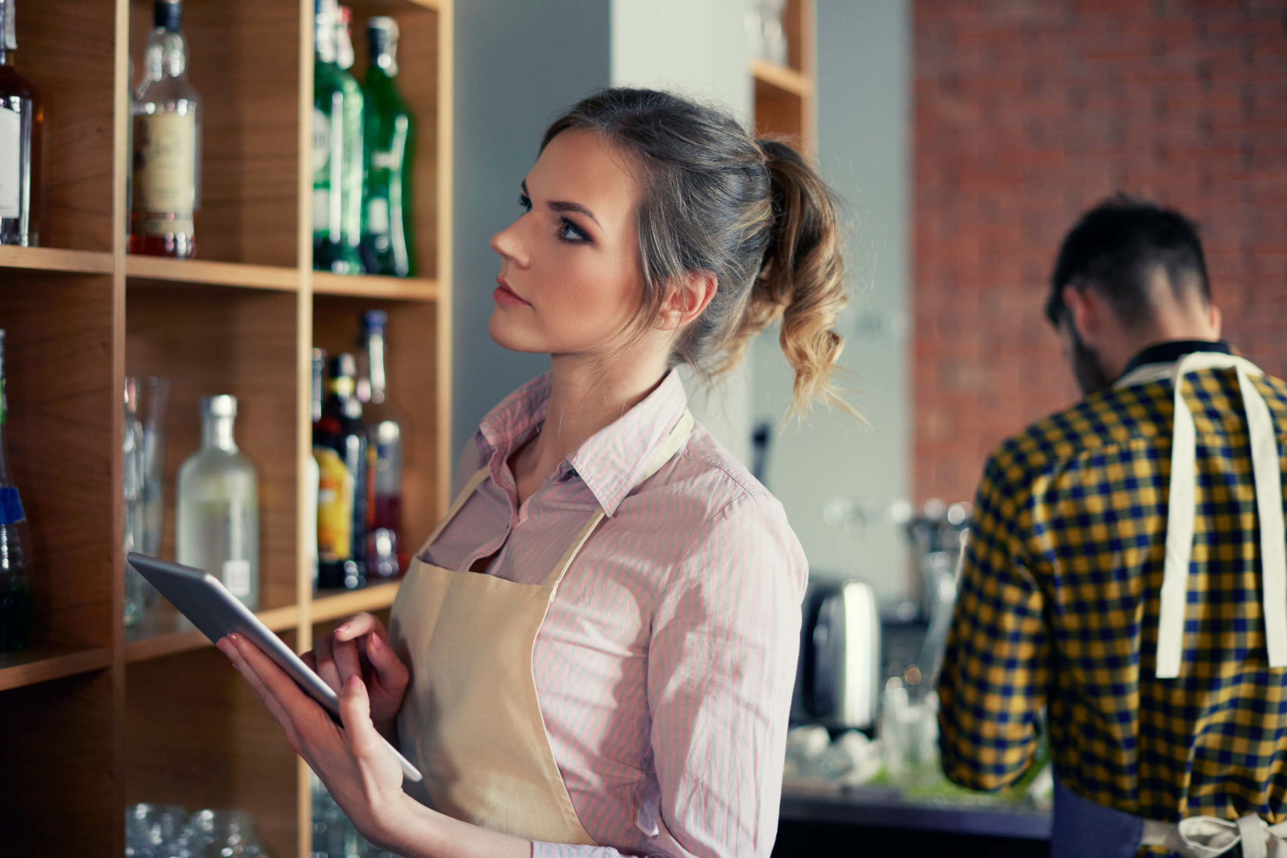 Waitress using bar inventory app
